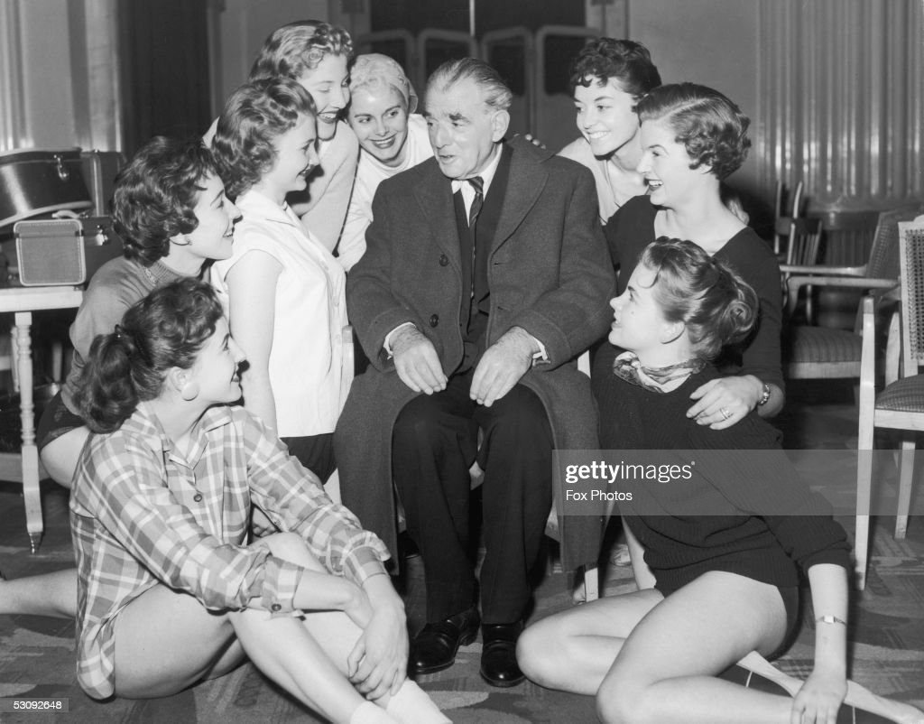 Theatre impressario Vivian Van Damm who created the Windmill Theatre and its famous revue, 4th February 1957. He is talking to Windmill girls as they rehearse for a 25th Anniversary television special.