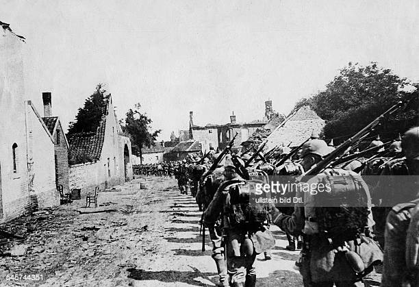 1WW Theatre of war western front BelgiumFrance augustseptember1914 German infantry passing through a belgian village august 1914
