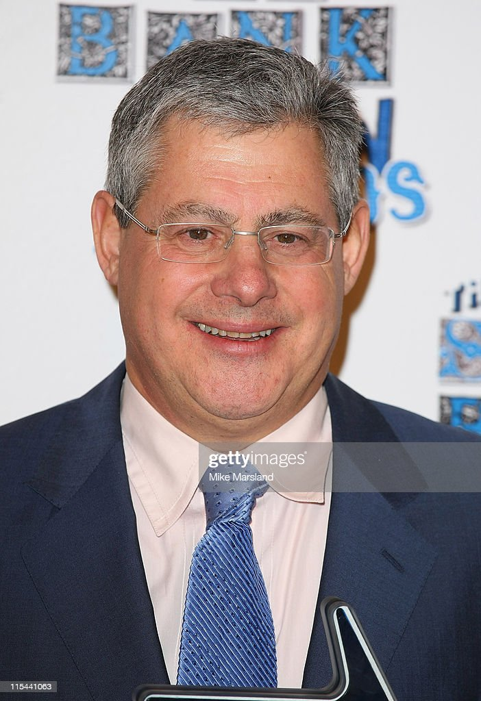 Theatre producer Sir <a gi-track='captionPersonalityLinkClicked' href=/galleries/search?phrase=Cameron+Mackintosh&family=editorial&specificpeople=217237 ng-click='$event.stopPropagation()'>Cameron Mackintosh</a> with his Outstanding Achievement Award during the South Bank Show Awards 2009 at the Dorchester Hotel on January 20, 2009 in London, England.