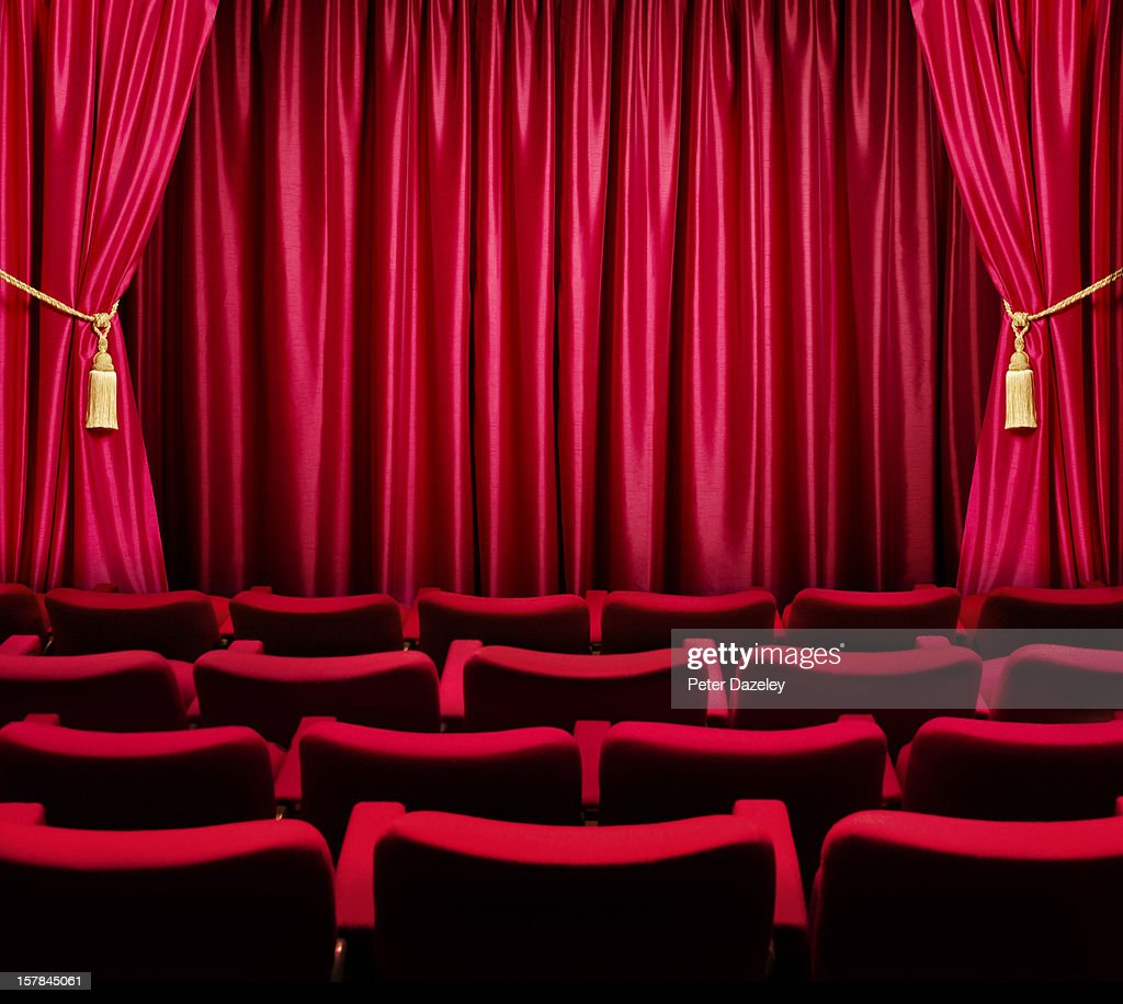 Closed theater curtains - Theatre Seats Facing A Closed Curtain Stock Photo