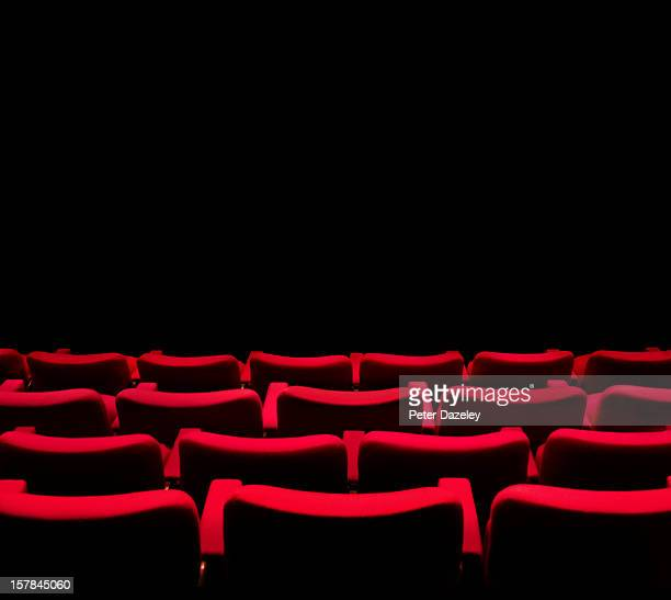 Theatre seats facinhg a dark wall or screen