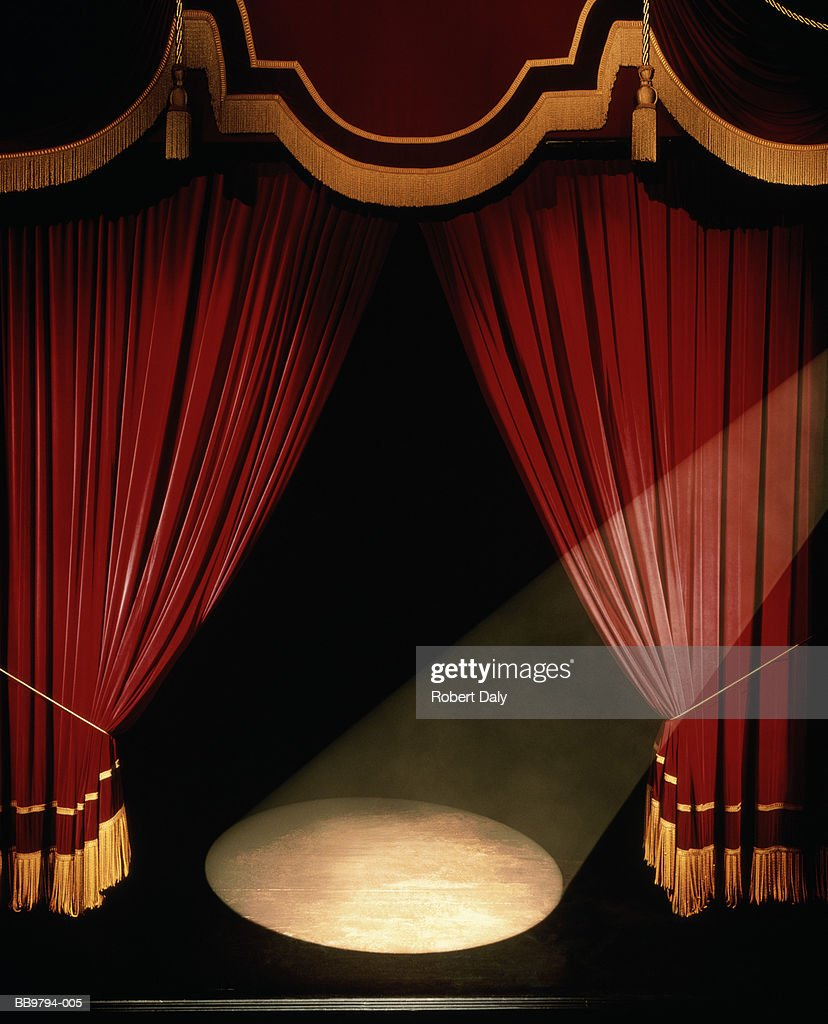 Big event red curtains with spotlight stock photo getty images - Theatre Stage Curtains And Spotlight Digital Enhancement Stock