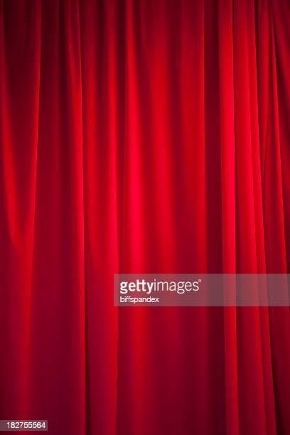 Theatrical, pleated, bright red silk curtain