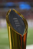 TheCollege Football Playoff National Championship trophy is on display before the start of the game between the Oklahoma State Cowboys and the...