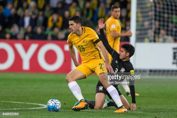 Theerathon Bunmathan of the Thailand National Football Team and Tom Rogic of the Australian National Football Team contest the ball during the FIFA...