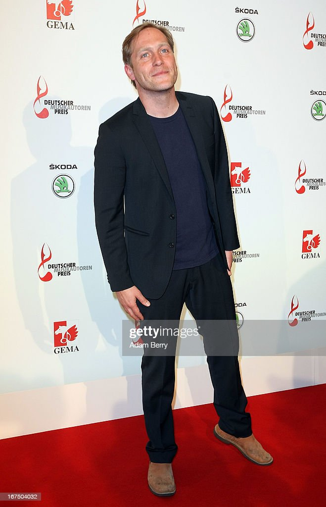 Thees Uhlmann arrives for the Deutscher Musikautorenpreis (German Songwriter Prize) 2013 ceremony at the Ritz Carlton hotel on April 25, 2013 in Berlin, Germany. The prize has been presented by GEMA (Gesellschaft fuer musikalische Auffuehrungs- und mechanische Vervielfaeltigungsrechte), the German society for musical performing and mechanical reproduction rights, since 2009.