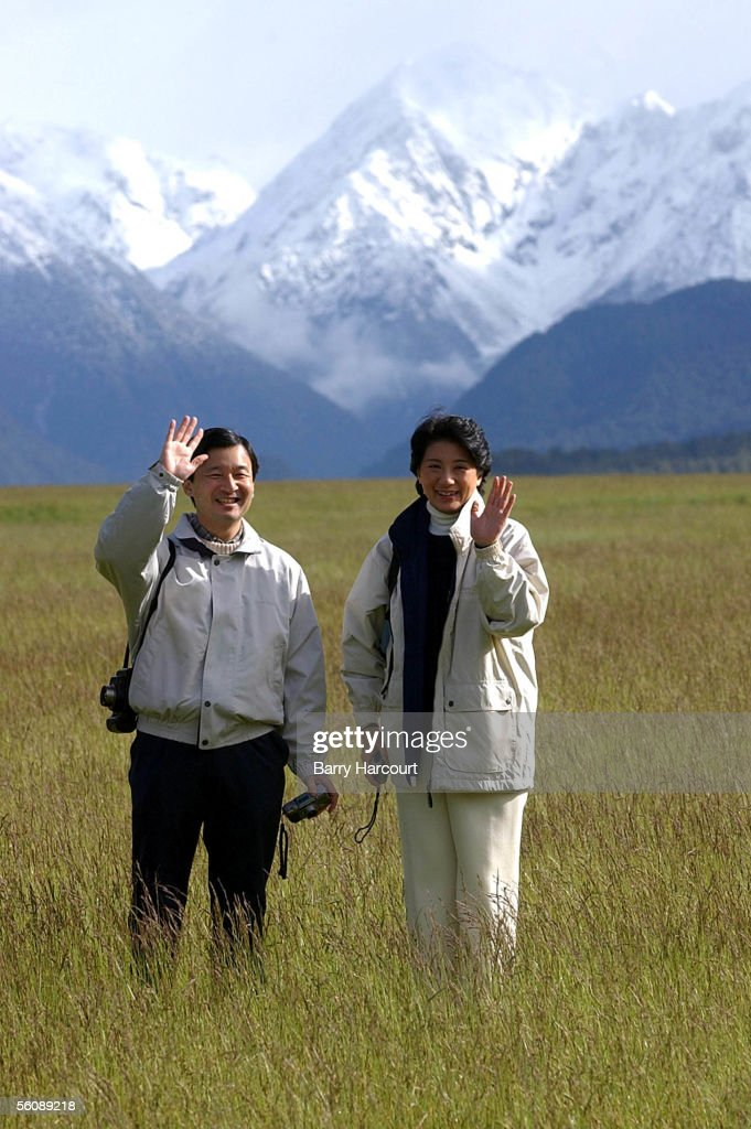 Their Imperial Highnesses Crown Prince Natuhito and <a gi-track='captionPersonalityLinkClicked' href=/galleries/search?phrase=Crown+Princess+Masako&family=editorial&specificpeople=580174 ng-click='$event.stopPropagation()'>Crown Princess Masako</a> of Japan wave to the media as they admire the admire the scenic Eglington Valley on their visit to Milford Sound in Te Anau, South Island, New Zealand, today Sunday 15th December 2002. The Crown Prince and Princess are on a 4 day visit of New Zealand.