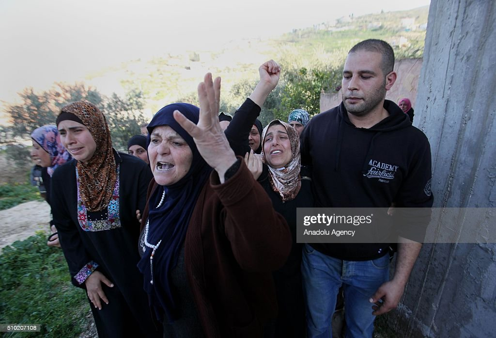 Their relatives mourn during the funeral ceremony of 2 15-year-old Palestinian teenagers, namely Nihad Raid and Fuad Mervan, who have been killed by Israeli soldiers, at El-Arka town of Jenin, West Bank on February 14, 2016.