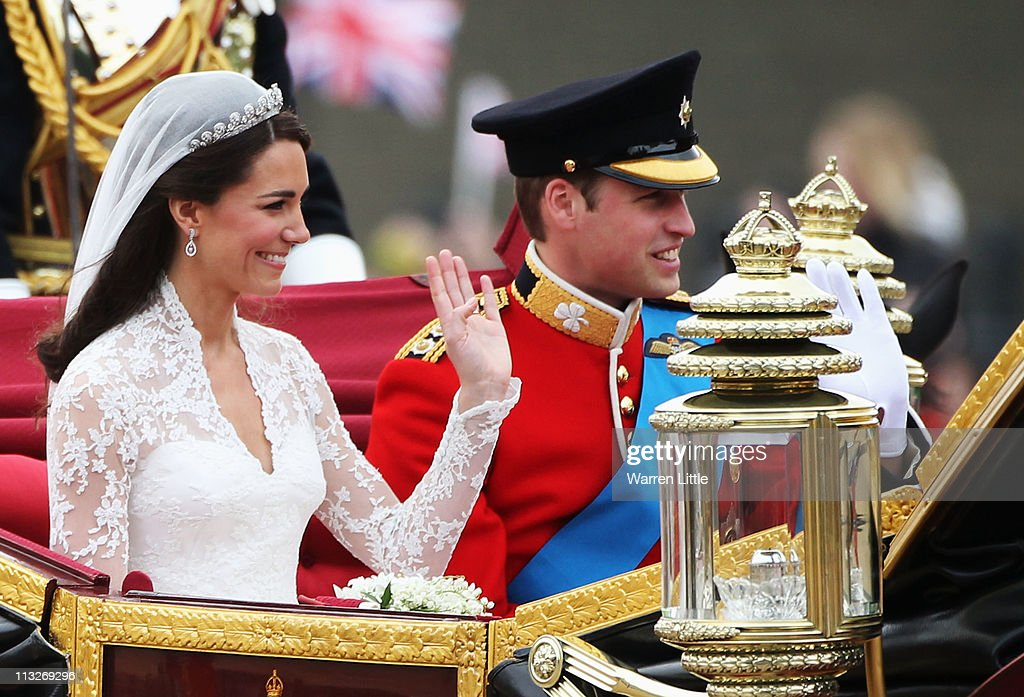 Their Royal Highnesses Prince William, Duke of Cambridge and <a gi-track='captionPersonalityLinkClicked' href=/galleries/search?phrase=Catherine+-+Herzogin+von+Cambridge&family=editorial&specificpeople=542588 ng-click='$event.stopPropagation()'>Catherine</a>, Duchess of Cambridge journey by carriage procession to Buckingham Palace following their marriage at Westminster Abbey on April 29, 2011 in London, England. The marriage of the second in line to the British throne is to be led by the Archbishop of Canterbury and will be attended by 1900 guests, including foreign Royal family members and heads of state. Thousands of well-wishers from around the world have also flocked to London to witness the spectacle and pageantry of the Royal Wedding.