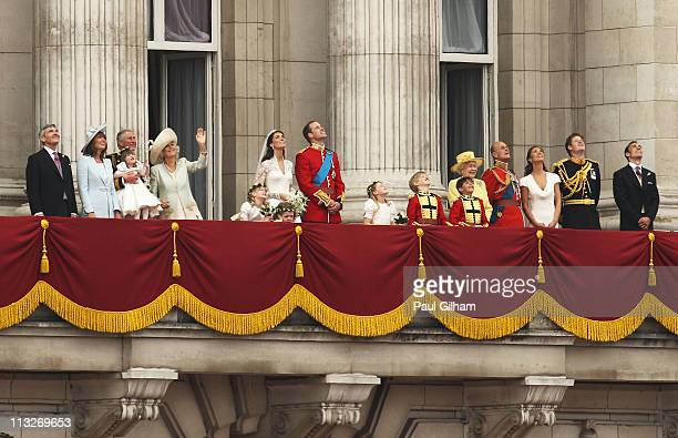 Their Royal Highnesses Prince William Duke of Cambridge and Catherine Duchess of Cambridge look up at the flypast over from the balcony at Buckingham...