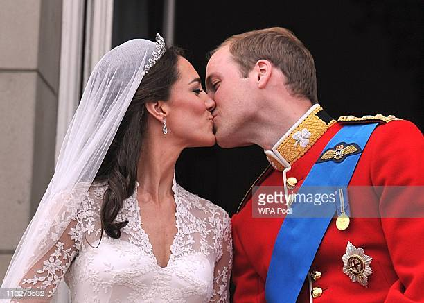 Their Royal Highnesses Prince William Duke of Cambridge and Catherine Duchess of Cambridge kiss on the balcony at Buckingham Palace during the Royal...