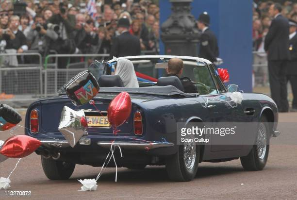 Their Royal Highnesses Prince William Duke of Cambridge and Catherine Duchess of Cambridge drive from Buckingham Palace to Clarence House in an old...