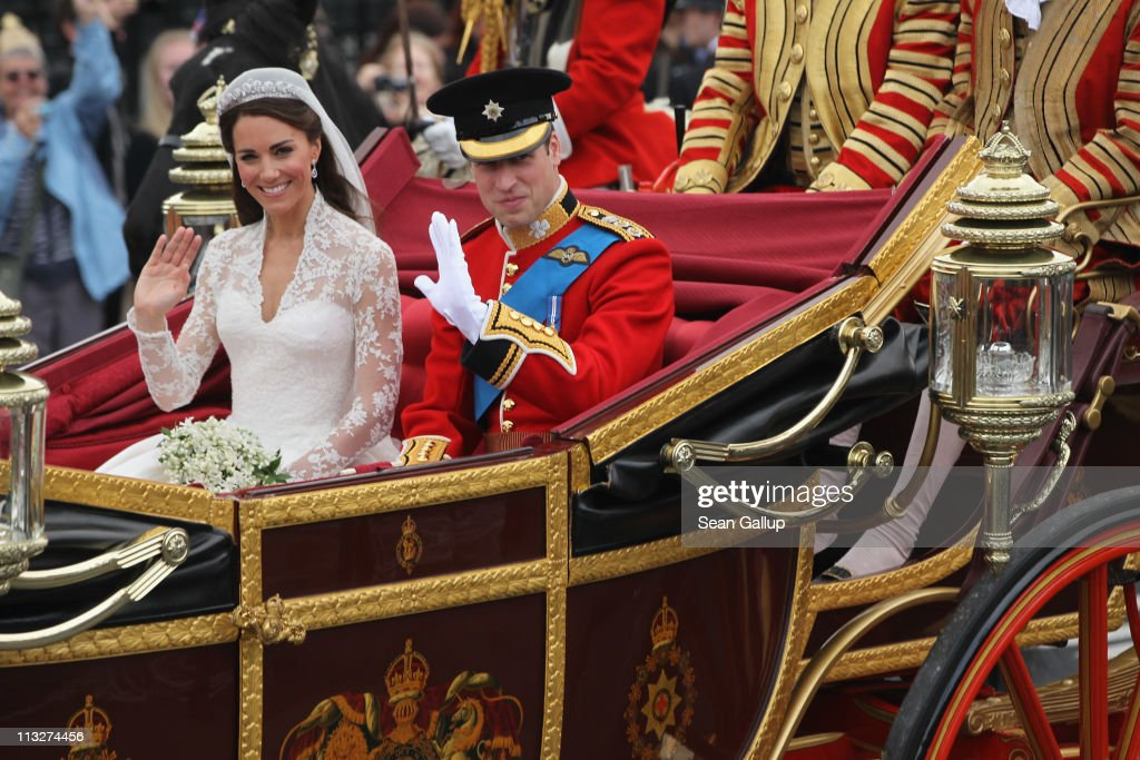 Their Royal Highnesses <a gi-track='captionPersonalityLinkClicked' href=/galleries/search?phrase=Prince+William&family=editorial&specificpeople=178205 ng-click='$event.stopPropagation()'>Prince William</a>, Duke of Cambridge and Catherine, Duchess of Cambridge journey by carriage procession to Buckingham Palace following their marriage at Westminster Abbey on April 29, 2011 in London, England. The marriage of the second in line to the British throne was led by the Archbishop of Canterbury and was attended by 1900 guests, including foreign Royal family members and heads of state. Thousands of well-wishers from around the world have also flocked to London to witness the spectacle and pageantry of the Royal Wedding.