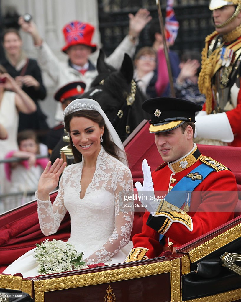 Their Royal Highnesses Prince William, Duke of Cambridge and Catherine, Duchess of Cambridge journey by carriage procession to Buckingham Palace following their marriage at Westminster Abbey on April 29, 2011 in London, England. The marriage of the second in line to the British throne was led by the Archbishop of Canterbury and was attended by 1900 guests, including foreign Royal family members and heads of state. Thousands of well-wishers from around the world have also flocked to London to witness the spectacle and pageantry of the Royal Wedding.