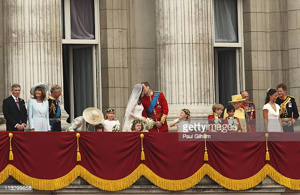 Their Royal Highnesses Prince William Duke of Cambridge and Catherine Duchess of Cambridge kiss from the balcony at Buckingham Palace on April 29...