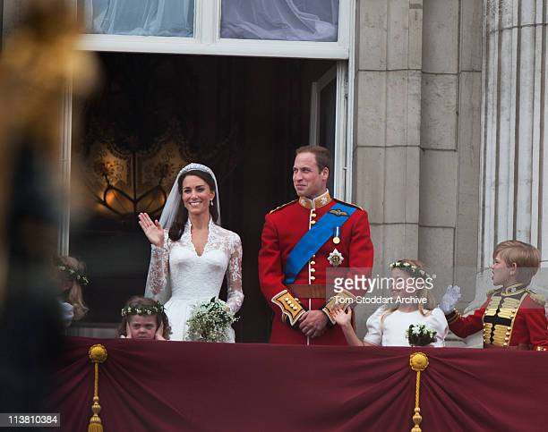 Their Royal Highnesses Prince William Duke of Cambridge and Catherine Duchess of Cambridge stand on the balcony at Buckingham Palace after their...