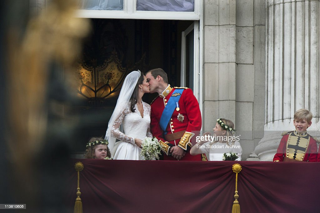 Their Royal Highnesses Prince William Duke of Cambridge and Catherine Duchess of Cambridge kiss on the balcony at Buckingham Palace after their...