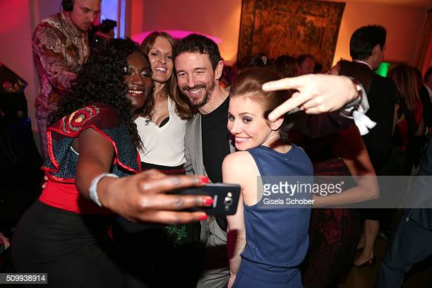 Thelma Buabeng Katrin Berben Oliver Berben and Josefine Preuss make a selfie during the Bunte and BMW Festival Night 2016 during the 66th Berlinale...