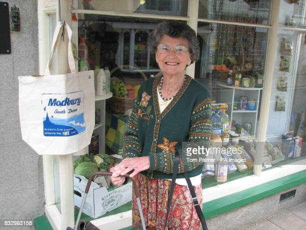 Thelma Butland Modbury resident in the town's high street shopping with reusable bags