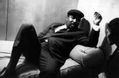 Thelonious Monk jazz musician lounging on a sofa