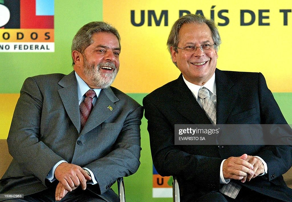 Then President of Brazil Luiz Inacio Lula da Silva talks with then Minister of the Civilian Household Jose Dirceu at the opening ceremony of the...