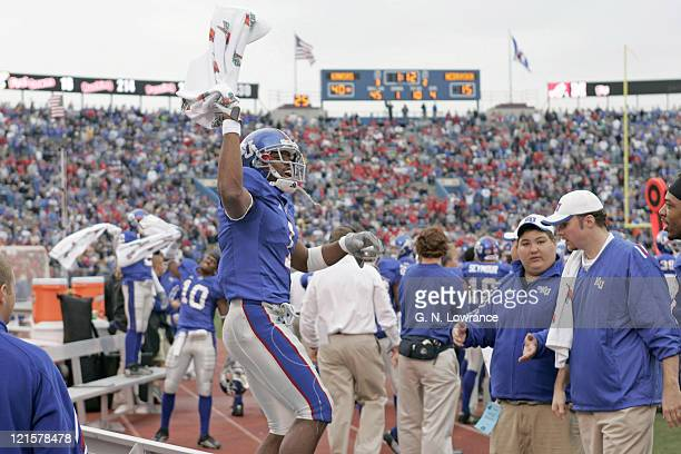 Theo Baines of the Kansas Jayhawks waves a towel as celebrations begin in the closing moments of a victory over the Nebraska Cornhuskers at Memorial...