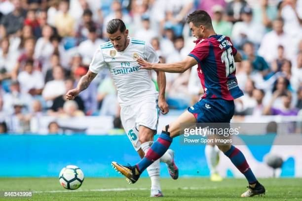 Theo Bernard Francois Hernandez Pi of Real Madrid fights for the ball with Sergio Postigo Redondo of Levante UD during the La Liga match between Real...