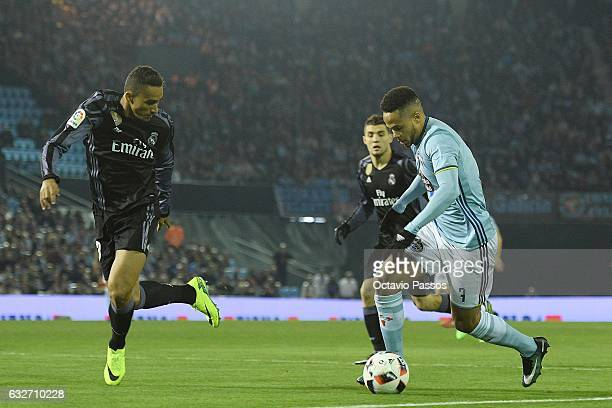 Theo Bongonda of Celta de Vigo competes for the ball with Danilo of Real Madrid during the Copa del Rey quarterfinal second leg match between Real...
