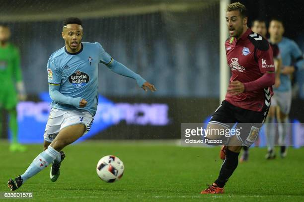 Theo Bongonda of Celta de Vigo competes for the ball with Victor Camarasa of Alaves during the Copa del Rey semifinal first leg match between Real...