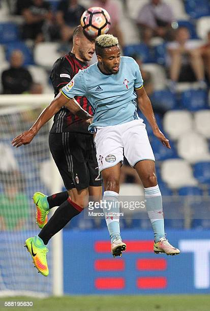 Theo Bongonda of Celta Vigo competes for the ball with Gabriel Paletta of AC Milan during the TIM Preseason Tournament at Mapei Stadium Citta' del...