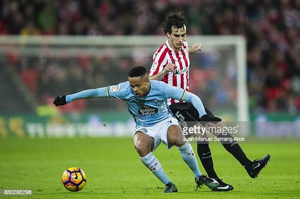 Theo Bongonda of RC Celta de Vigo competes for the ball with Inigo Lekue of Athletic Club during the La Liga match between Athletic Club Bilbao and...