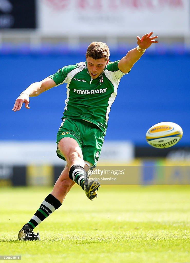 Theo Brophy Clews of London Irish kicks during the Aviva Premiership match between London Irish and Harlequins at the Madejski Stadium on May 01, 2016 in Reading, England.