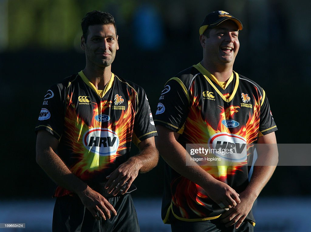 Theo Doropoulos (L) and Jesse Ryder of Wellington leave the field after winning the HRV Cup Twenty20 Preliminary Final between the Wellington Firebirds and the Auckland Aces at Basin Reserve on January 18, 2013 in Wellington, New Zealand.