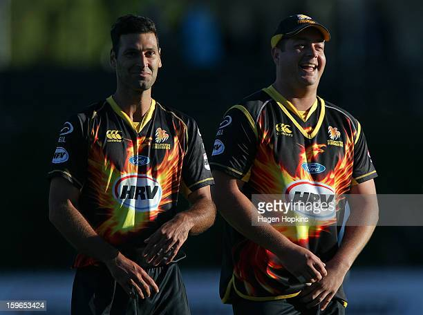 Theo Doropoulos and Jesse Ryder of Wellington leave the field after winning the HRV Cup Twenty20 Preliminary Final between the Wellington Firebirds...