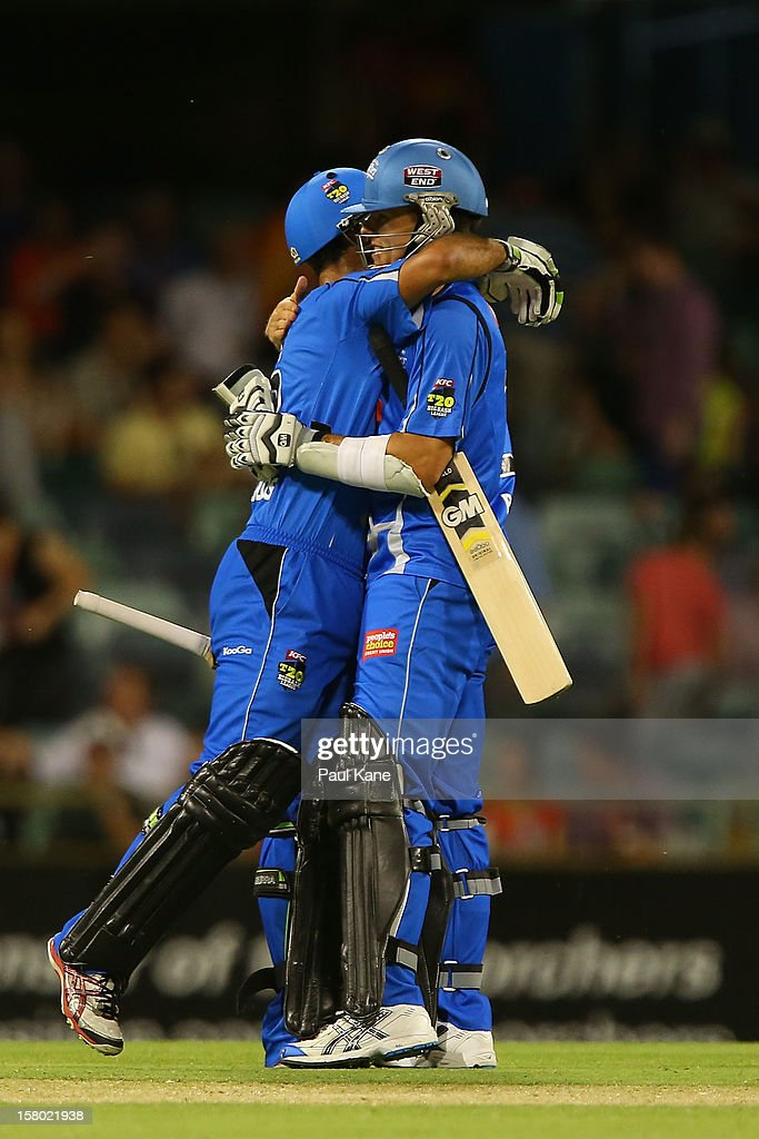 Theo Doropoulos and Johan Botha of the Strikers celebrate winning the Big Bash League match between the Perth Scorchers and Adelaide Strikers at WACA on December 9, 2012 in Perth, Australia.