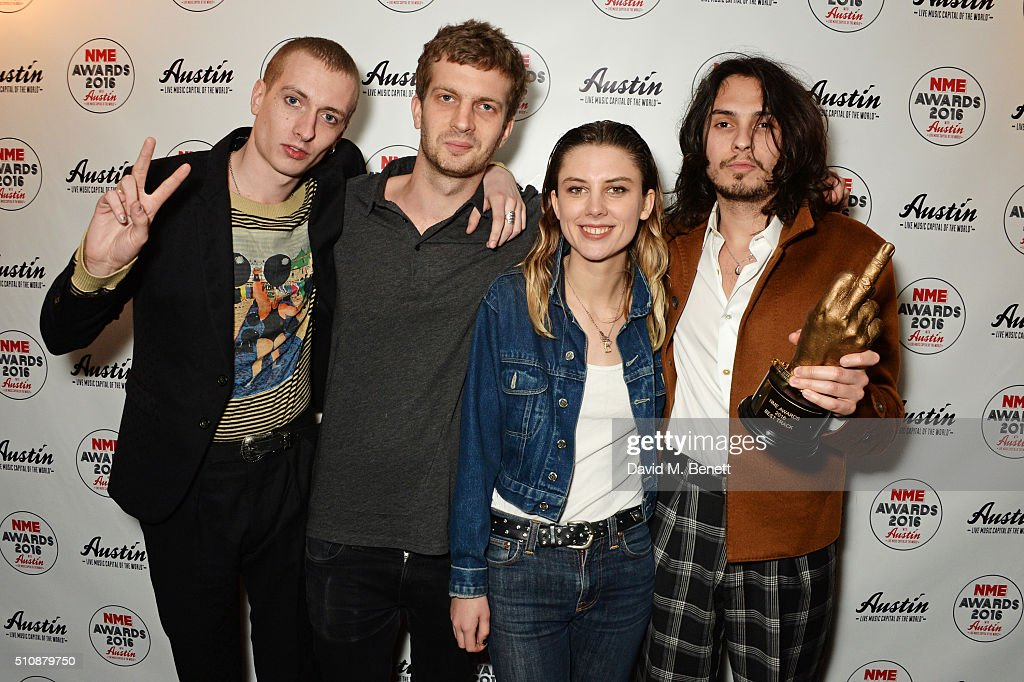 Theo Ellis Joff Oddie Ellie Roswell and Joel Amey of Wolf Alice winners of the Best Track award at 'Giant Peach' pose in the Winners Room at the NME...