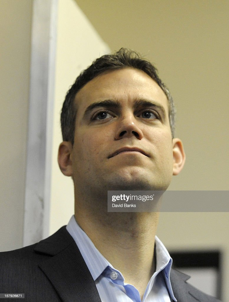 Theo Epstein, President of Baseball Operations for the Chicago Cubs watches as new pitcher Kyuji Fujikawa is introduced to the media on December 7, 2012 at Wrigley Field in Chicago, Illinois.