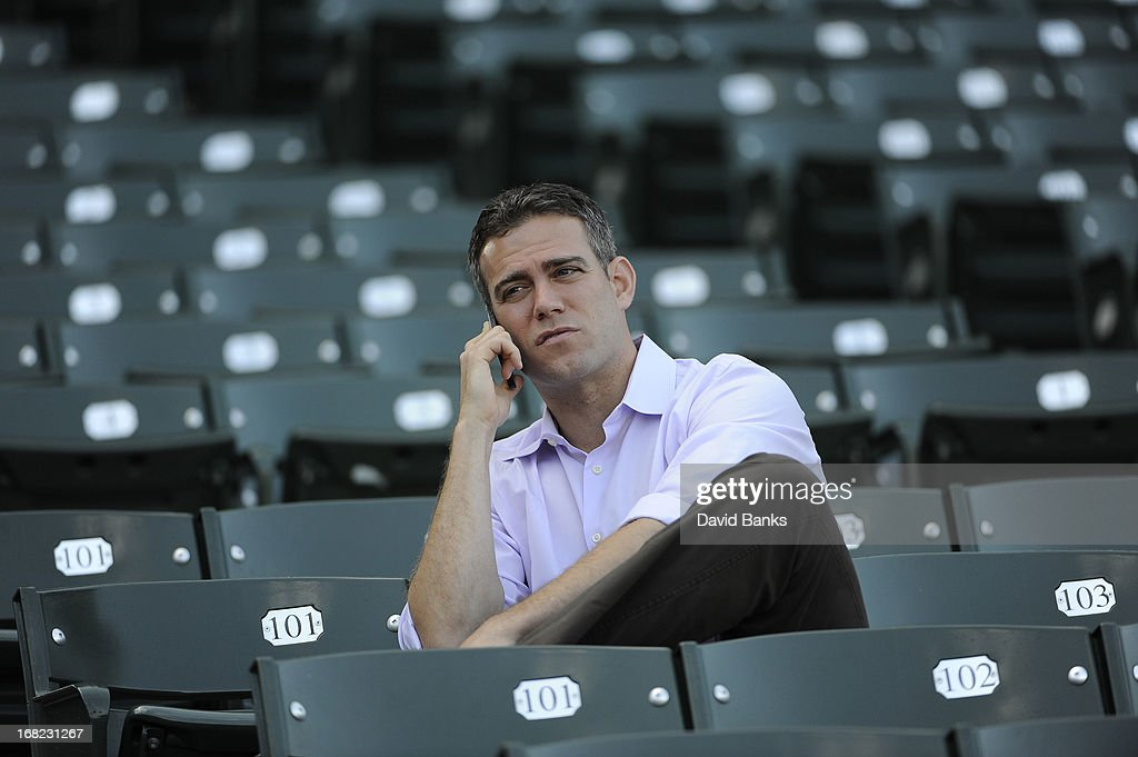 Theo Epstein President of Baseball Operations for the Chicago Cubs watches batting practice before the game between the Chicago Cubs and the San Diego Padres on May 1, 2013 at Wrigley Field in Chicago, Illinois.