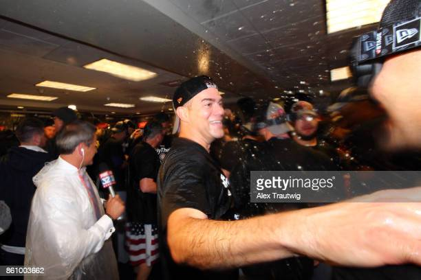 Theo Epstein President of Baseball Operations for the Chicago Cubs celebrates in the clubhouse after winning Game 5 of the National League Division...
