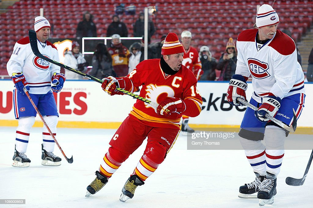 Theo Fleury #14 of the Calgary Flames skates against the Montreal Canadiens for the 2011 Heritage Classic Alumni Game on February 19, 2011 at McMahon Stadium in Calgary, Alberta, Canada.