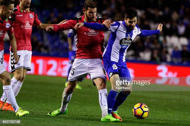 Theo Hernandez defender of Deportivo Alaves battles for the ball with Carles Gil midfielder of Deportivo de La Coruña during the La Liga Santander...