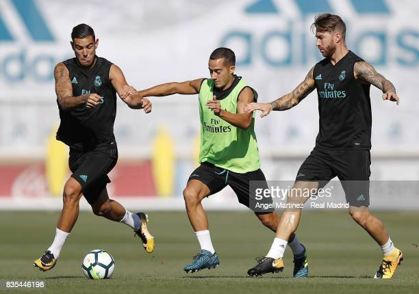 Theo Hernandez Lucas Vazquez and Sergio Ramos of Real Madrid in action during a training session at Valdebebas training ground on August 19 2017 in...