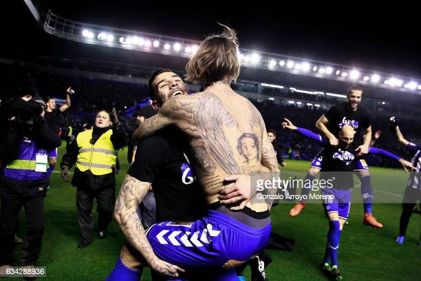 Theo Hernandez of Deportivo Alaves celebrates their victory with team mate Alexis Ruano after the Copa del Rey semifinal second leg match between...