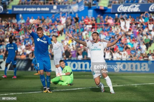 Theo Hernandez of Real Madrid CF protests after his goal was disallowed during the La Liga match between Getafe and Real Madrid at Coliseum Alfonso...