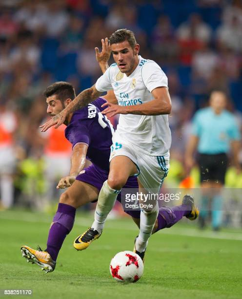 Theo Hernandez of Real Madrid CF runs past Marco Benassi of ACF Fiorentina during the Santiago Bernabeu Trophy match between Real Madrid CF and ACF...