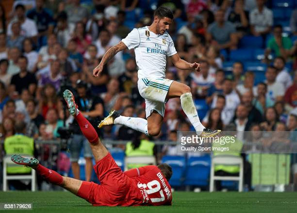 Theo Hernandez of Real Madrid competes for the ball with Bartlomiej Dragowski of Fiorentina during the Trofeo Santiago Bernabeu match between Real...