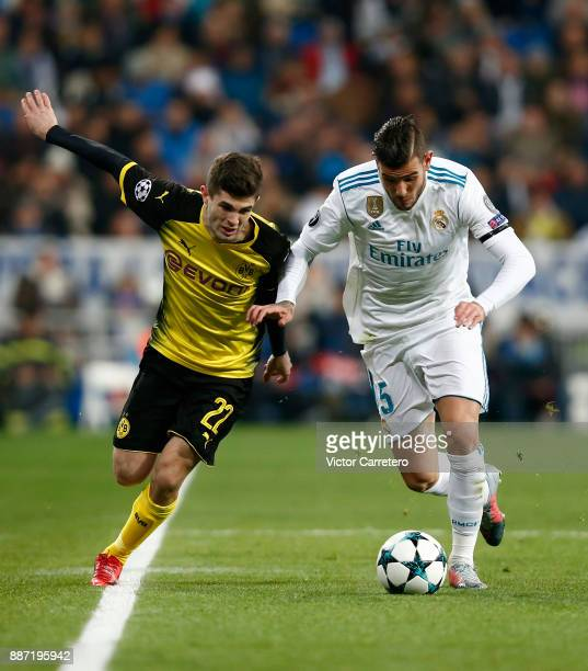 Theo Hernandez of Real Madrid competes for the ball with Christian Pulisic of Borussia Dortmund during the UEFA Champions League group H match...