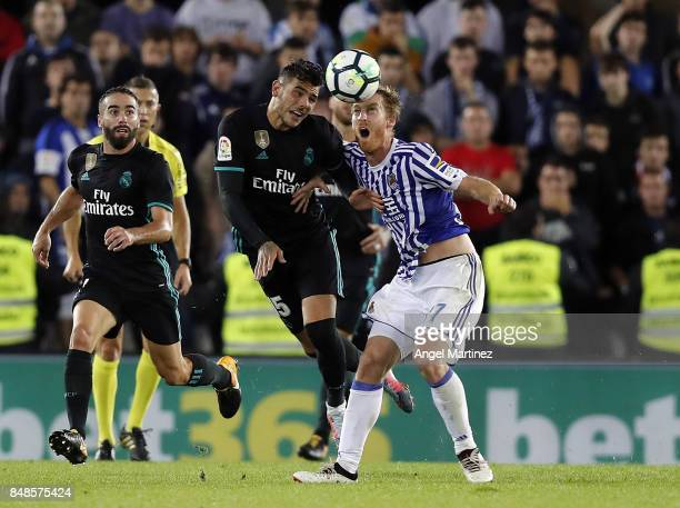 Theo Hernandez of Real Madrid competes for the ball with David Zurutuza of Real Sociedad during the La Liga match between Real Sociedad and Real...