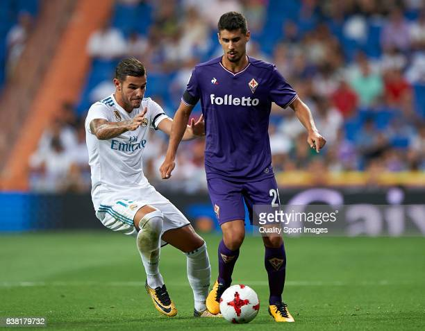 Theo Hernandez of Real Madrid competes for the ball with Gil Dias of Fiorentina during the Trofeo Santiago Bernabeu match between Real Madrid and ACF...