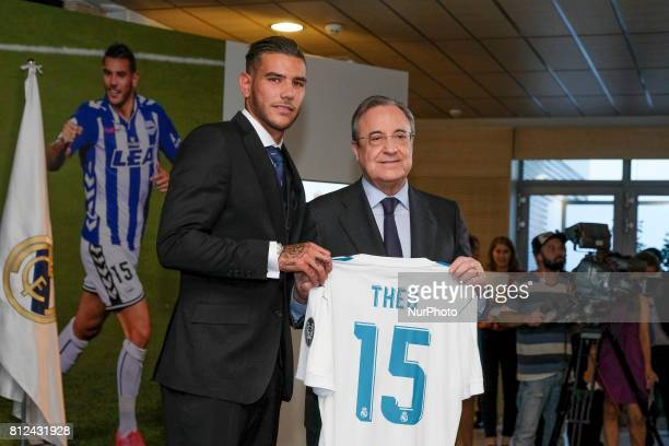 Theo Hernandez of Real Madrid poses with President Florentino Perez during his official presentation at Estadio Santiago Bernabeu on July 10 2017 in...